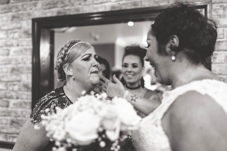 bridesmaid congratulating bride