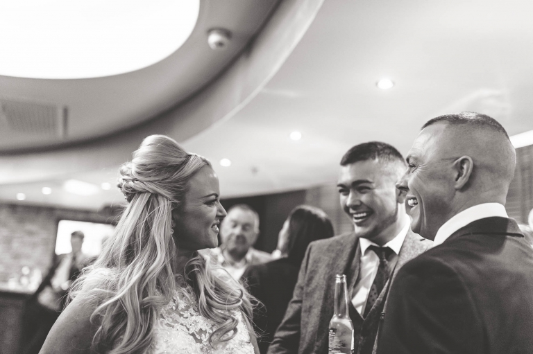 bride sharing joke with guests
