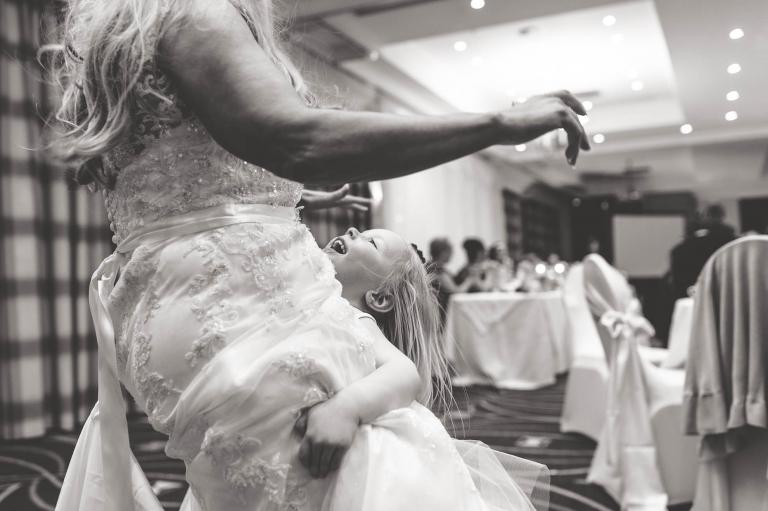 little girl holds bride