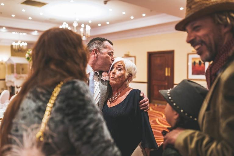 son giving mum a kiss