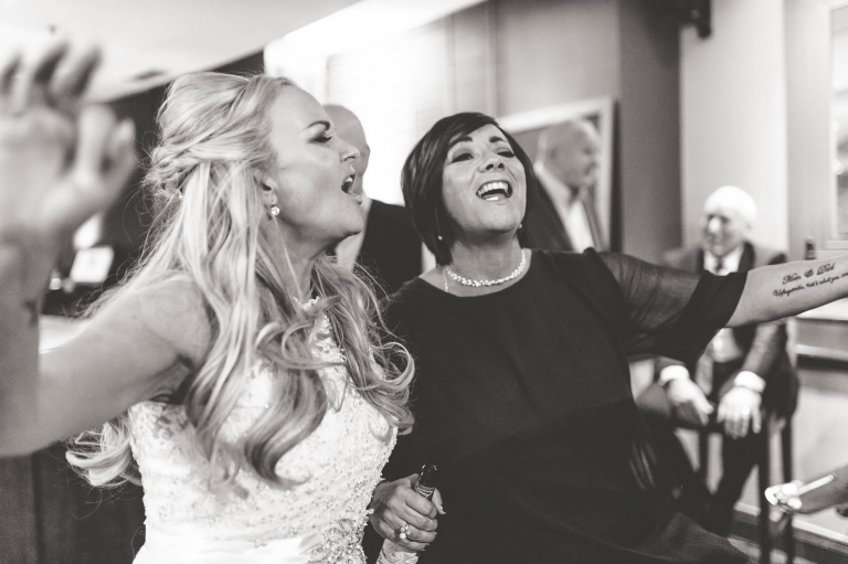 bride singing with guest