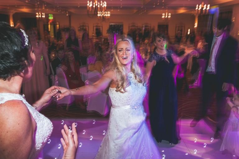 bride dancing with partner