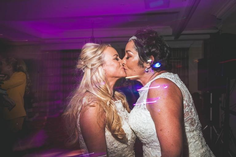 same sex couple kissing