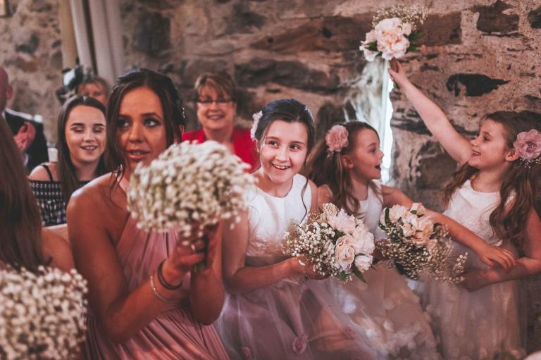 bridesmaids and flower girls cheer