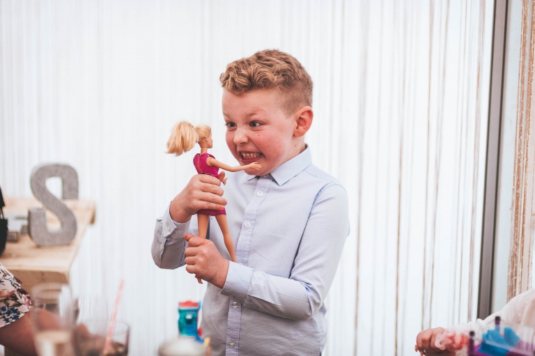 Little boy plays with doll