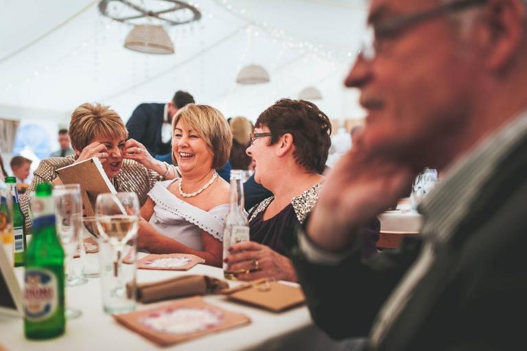 Guests share a joke at wedding breakfast