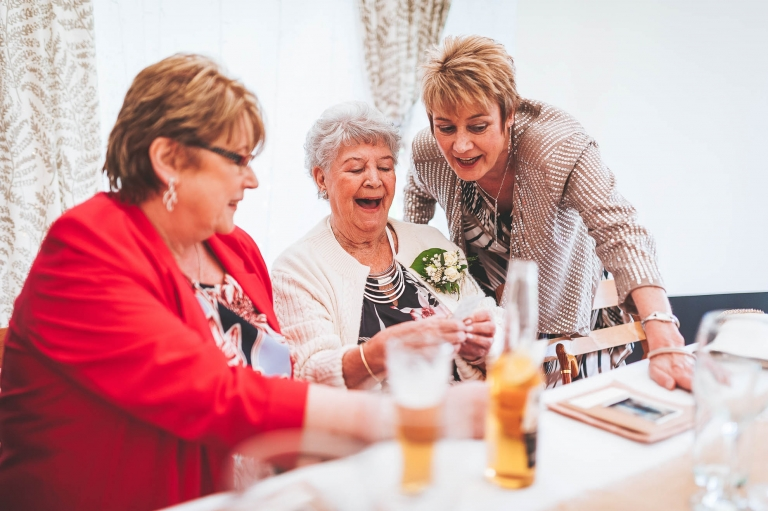 Nan share a joke with mother of the bride