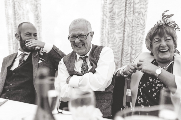 Mother and father of the groom laugh at best mans joke