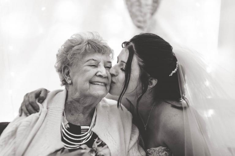 Bride gives nan a kiss