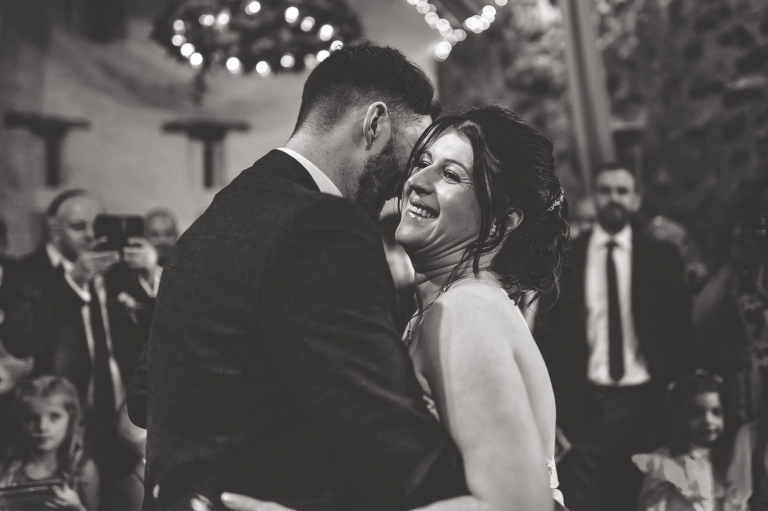 Bride laughs during first dance