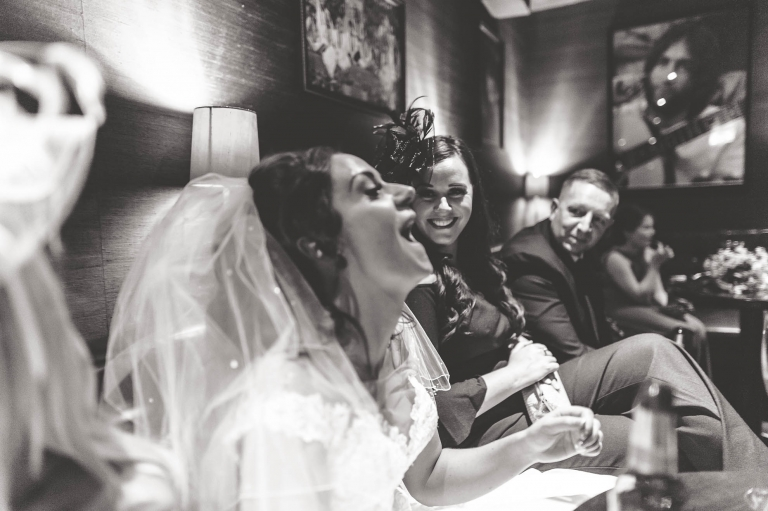 Bride laughing with a guest