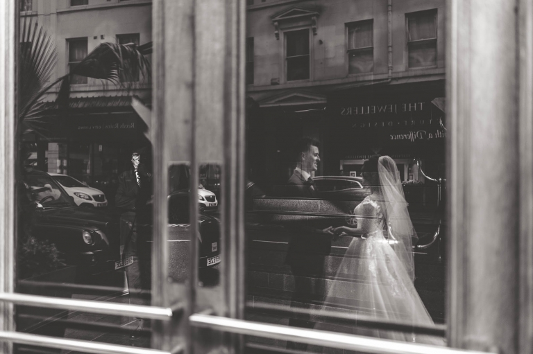 Bride and groom in reflection