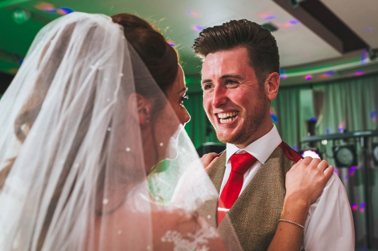 groom laughs during first dance