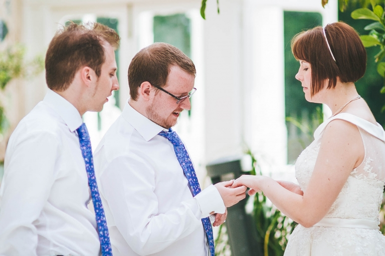 Best man looks at brides ring
