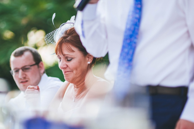 Mother of the groom smiles