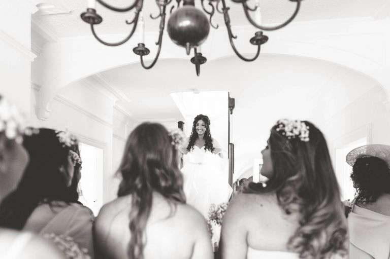 Bride enters the room in her dress