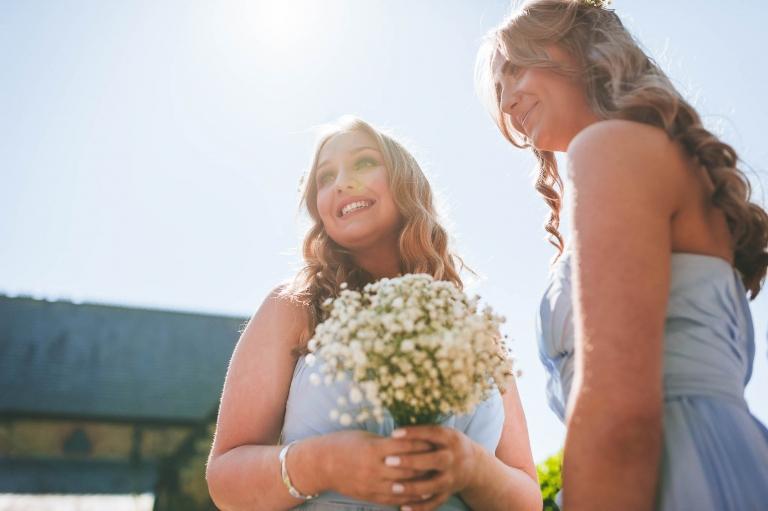 Bridesmaids wait at the church