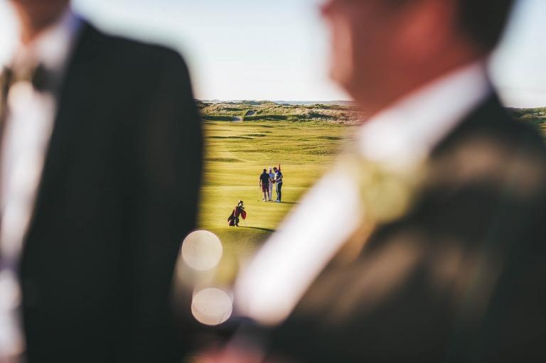 golfers in distance