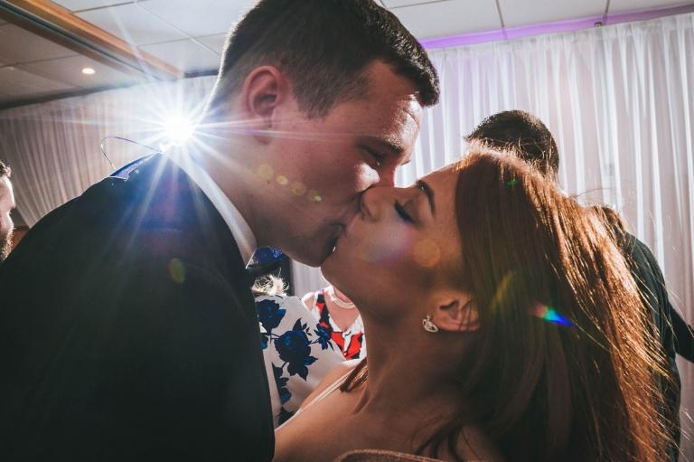 Guests kiss on dancefloor