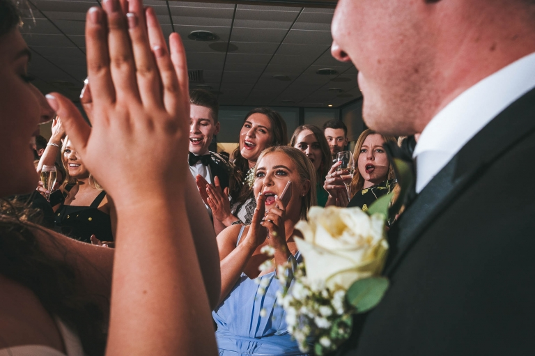 Guests cheer bride and groom