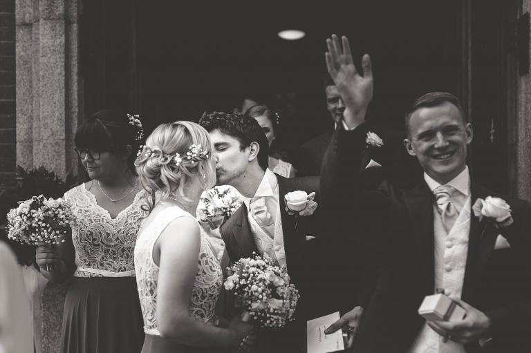 Usher and bridesmaid kiss