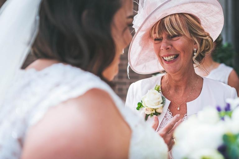 Mother of the groom congratulates bride