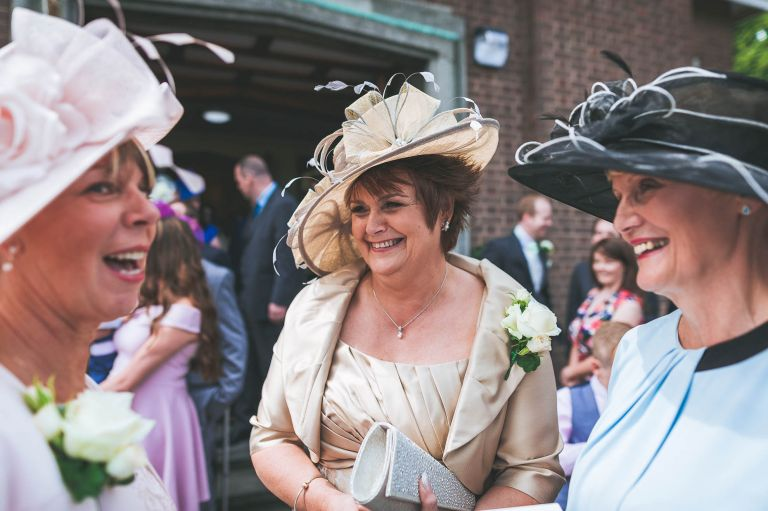 Mother of the bride and groom share a joke