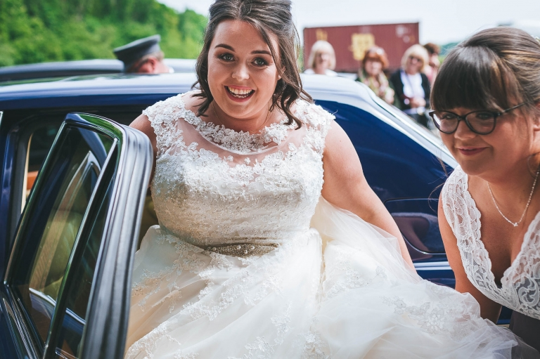 Bride arrives at the church in the wedding car
