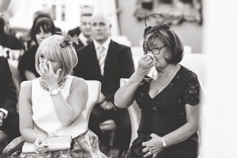 Guests shedding tears during the exchange of vows