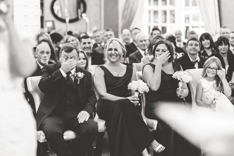 Bridesmaids shedding a tear after newlyweds being announced husband and wife