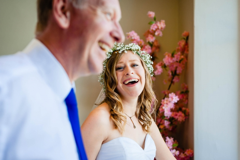 Bride share a joke with her father