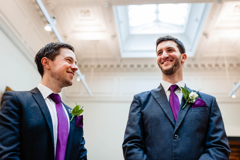 Groom share a joke with his best man