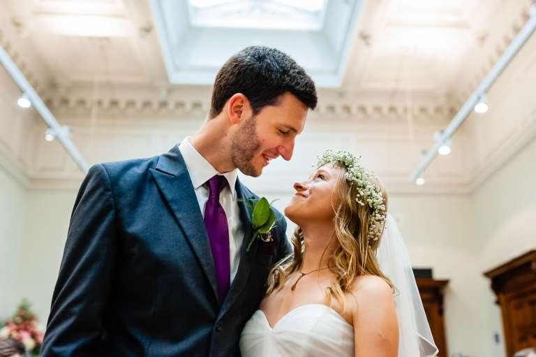 Bride and groom look into each others eyes after the exchange of rings
