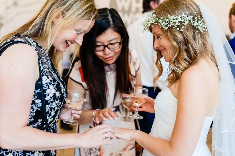 Guests admire brides wedding ring