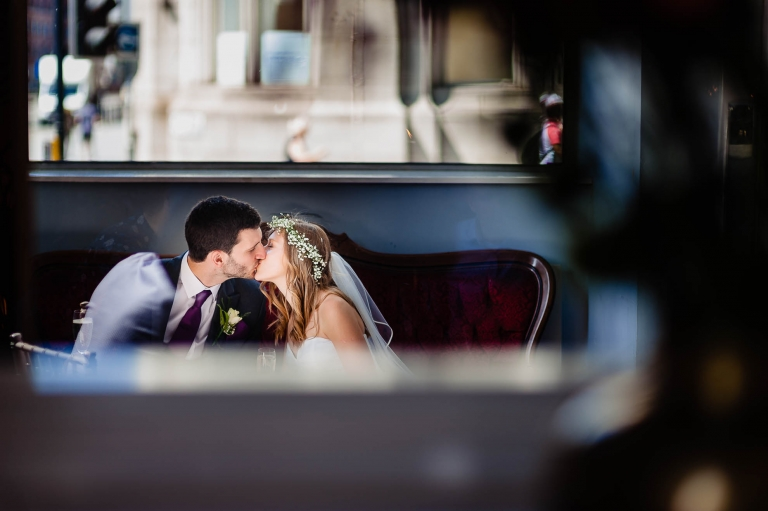Bride and groom kiss in reception of Oh Me Oh My
