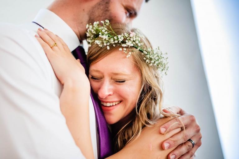 Bride and groom have an emotional hug