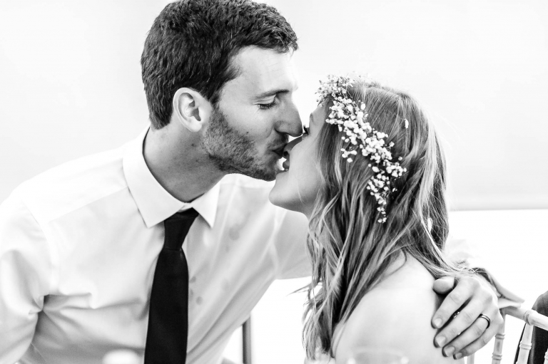 Groom kisses the bride on the nose