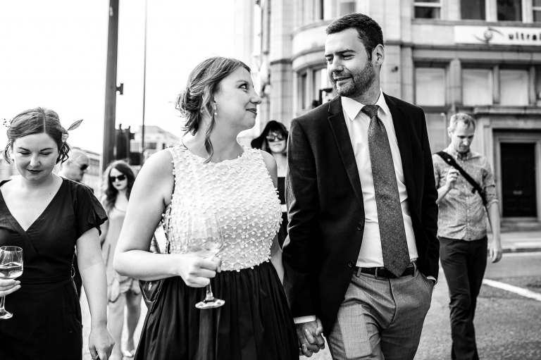 Guests smile at each other during wedding reception