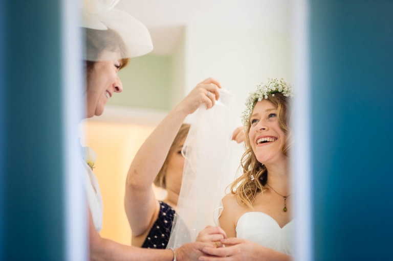 Bride and her mother share a joke during the bridal preparations