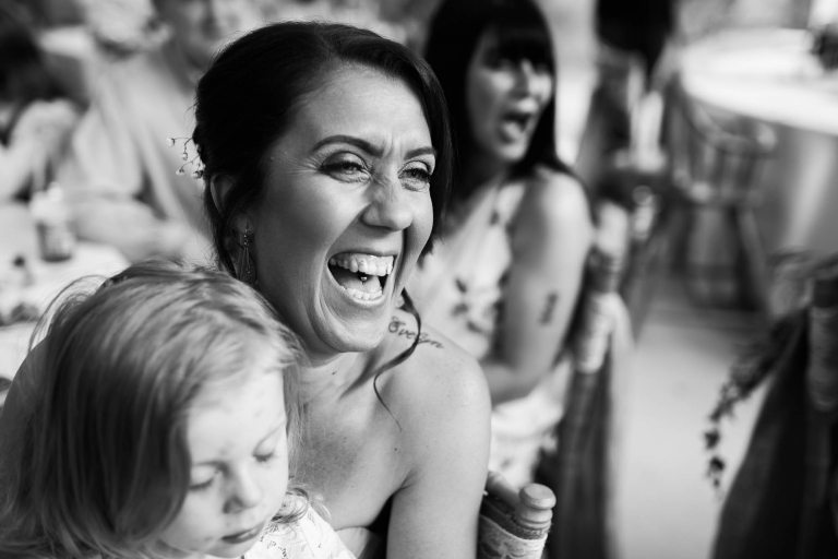 Bridesmaid laughs at wedding speech