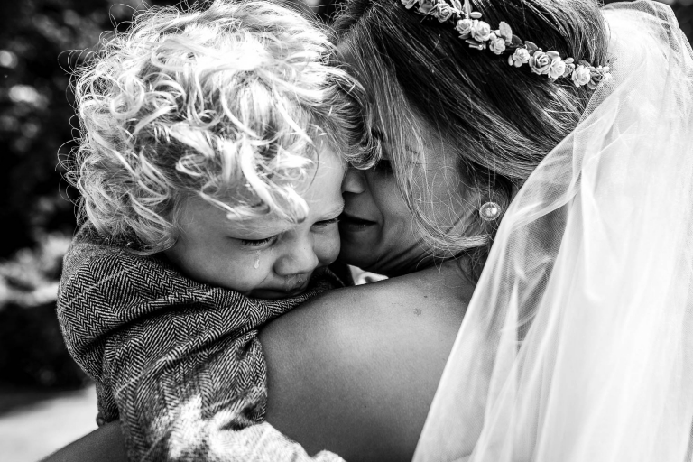 bride gives her son a hug