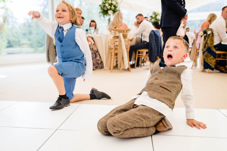 Kids react to a trick during the wedding breakfast