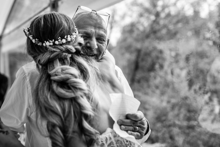 Bride hugs step-father during speeches