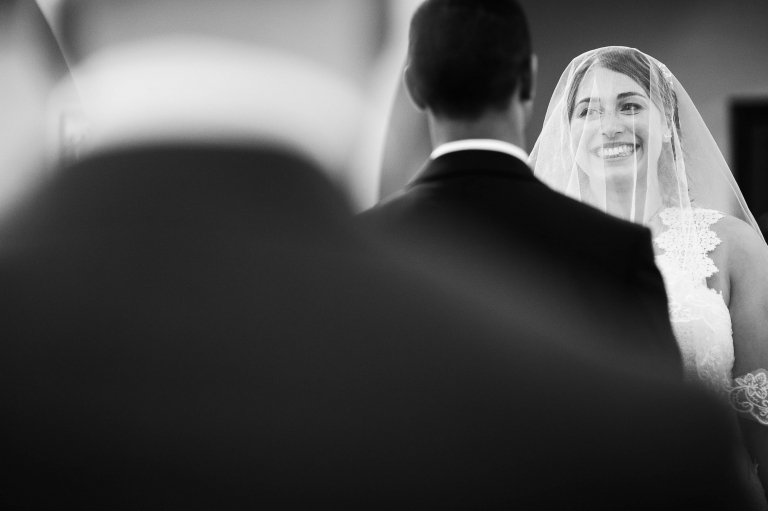 Bride smiles at the groom during the wedding vows
