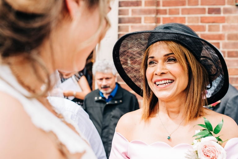 Mother of the bride congratulates the bride