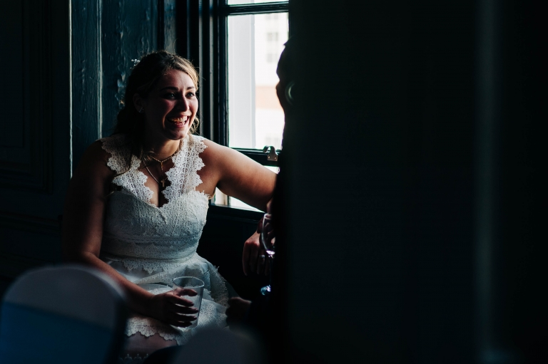 Bride shares a joke with the groom