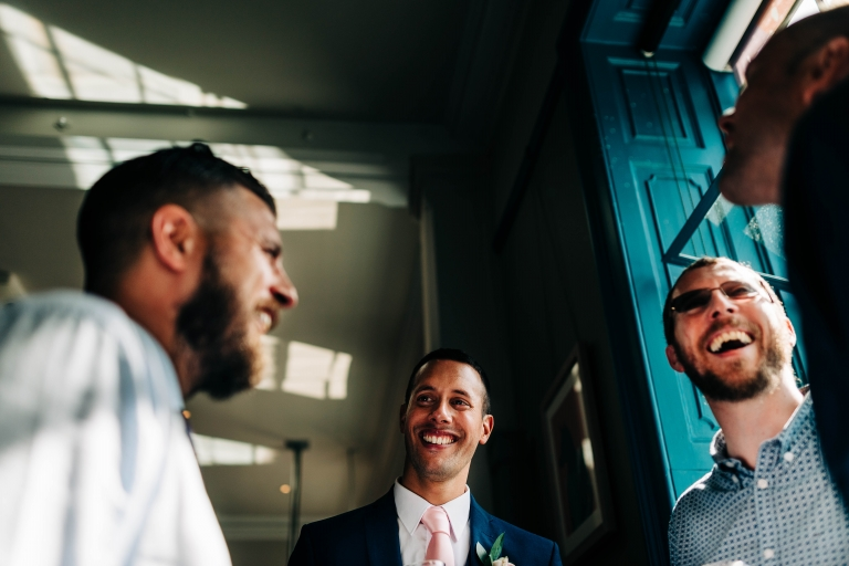 Groom shares a joke with wedding guests