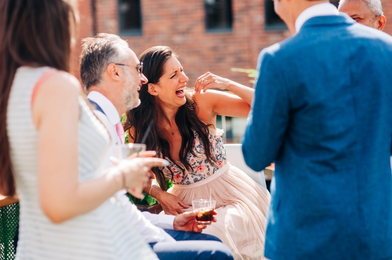 Wedding guests sharing a joke