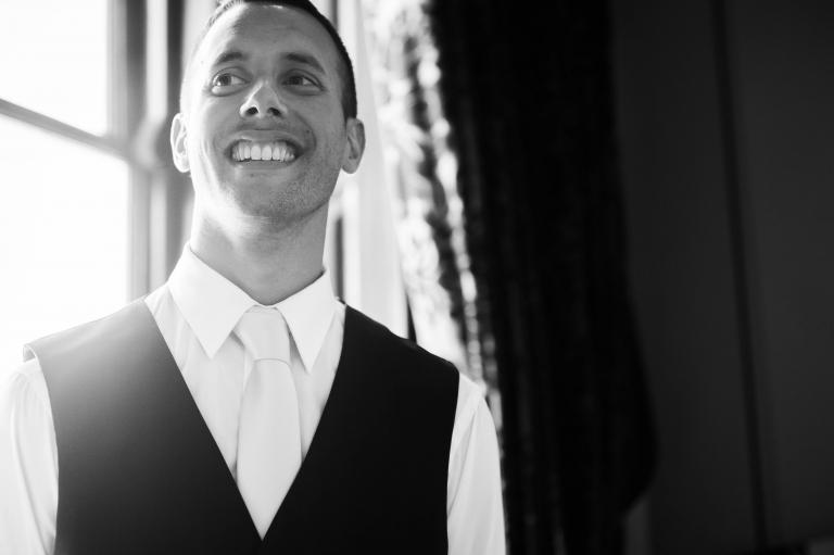 Groom smiles during speeches