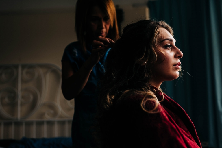Profile of the bride as she has her hair done